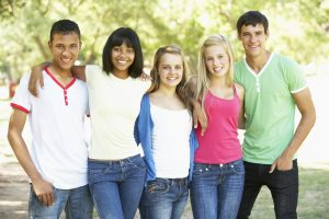 Group Of Teenage Friends Standing In Park