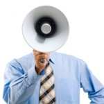 Image of man standing in front of camera and speaking into megaphone